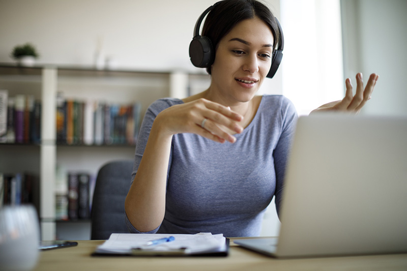 Woman with computer participating in continuing professional development